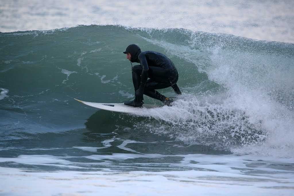 Surfer on a wave at Unstad Beach